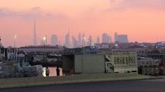 Old dock area at Dubai Creek, dusk to nightfall timelapse, stevedores unload Stock Footage