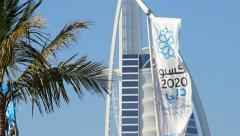 Dubai candidate city, World Expo 2020, logo and arabic inscription on white flag Stock Footage