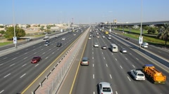Sparse daytime traffic, cars run along widest Sheikh Zayed highway Stock Footage