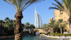 Madinat Jumeirah, architectural resort, palm trees around artificial lake Stock Footage