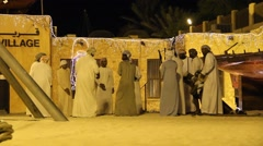 Group of Middle Eastern men in traditional arab clothes sing and play music Stock Footage