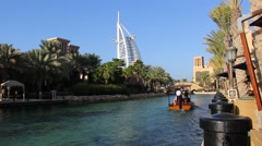 Burj Al Arab seen from Madinat Jumeirah, man-made channels system Stock Footage