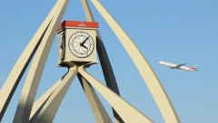 Dubai Clock Tower face close up, Emirates airliner fly on background - stock footage
