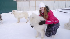 Young girl playing with a white dog Stock Footage