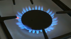One gas burners burn blue flame on a gas stove Stock Footage