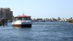 Abra ferry boats fuss across Dubai Creek at day, telephoto view, time lapse Stock Footage