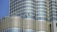 Burj Khalifa facade inspection and window cleaning by rope access Stock Footage