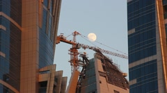 Tower crane, unfinished building construction site telephoto view Stock Footage