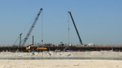 Building concrete bank at man-made island, complete falsework Stock Footage