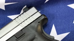 Handgun with United States flag - The Right to Bear Arms Stock Footage