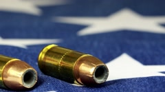 Ammunition on United States flag - Second Amendment Rights Stock Footage