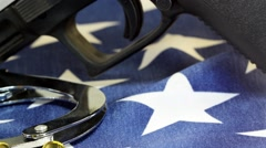 Handcuffs and ammunition on United States Flag - stock footage