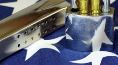 Padlock with firearms ammunition on American flag - stock footage