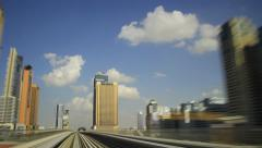 Time lapse drive at elevated railroad, Dubai Metro train pass city, rear cabin Stock Footage