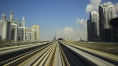 POV cabin view, metro train rush at overground railway, modern Arabic city Stock Footage