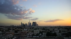 Afterglow to darkness sky time lapse. Light dark clouds over Dubai skyline Stock Footage