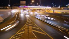 Night highway exit, rapid traffic, car turn out from main road, time lapse shot Stock Footage