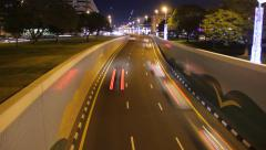 Fast night traffic move from junction underpass exit, time lapse shot Stock Footage