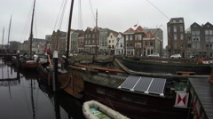 Dutch old houseboat floating house with renewable energie on roof 4k - stock footage