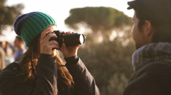 Girl with a camera takes memoirs of a travel with her boyfriend, winter time Stock Footage