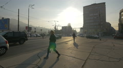 People walking and driving cars on Obala Kulina bana street in Sarajevo Stock Footage