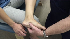 Therapist working on patient's foot and ankle. - stock footage