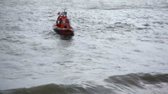 Coast guard rescue boat turns around, Cascais port harbor, Portugal Stock Footage