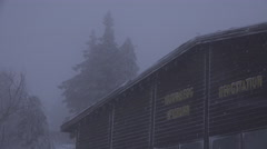 4k Cable car station roof Wurmberg Harz snow storm Stock Footage