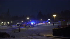 4k Ambulance car flashing blue light nightshot leaving Wurmberg Stock Footage