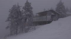 4k Lost wooden building ski resort Wurmberg Harz snow storm Stock Footage