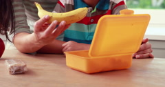 Mother preparing sons lunch box Stock Footage