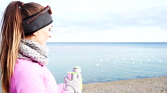 Woman fit sport girl outdoor in cold day warming up drink tea 4K Stock Footage