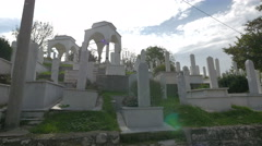 Tombstones and cupolas in Groblje Alifakovac cemetery in Sarajevo - stock footage