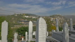 Trees and white tombstones in Groblje Alifakovac cemetery in Sarajevo Stock Footage