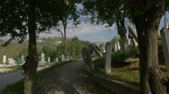 Narrow alley between the Groblje Alifakovac cemetery's tombstones in Sarajevo Stock Footage
