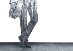 Businessman's legs and forest double exposure b/w image - stock illustration