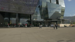Walking next to the Sarajevo City Center, a shopping mall in Sarajevo Stock Footage