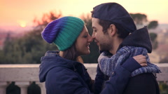 girl and her boyfriend kissing with passion in a public park - stock footage