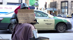 African American male sitting on sidewalk with sign asking for help 4k Stock Footage