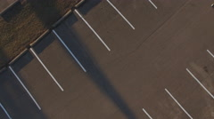 Rotating above empty parking spots in lot aerial view 4k Stock Footage