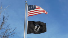 American and POW MIA Flags Blowing in the Wind Stock Footage