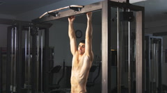 Man showing impressive strength, doing a Muscle Up on horizontal bar. - stock footage