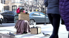 Man holding cardboard sign asking for help in downtown Chicago 4k Stock Footage