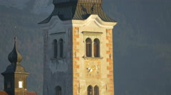 Clock on Church of the Assumption of Maria tower, Bled - stock footage