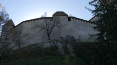 The wall of Bled Castle seen from the lake, Bled Stock Footage