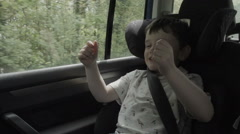 A little boy is copying his parent and using imaginative play to drive a car. - stock footage