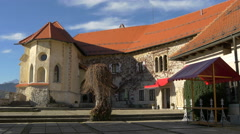 Walking in the courtyard of Bled Castle, Bled Stock Footage