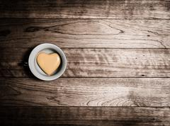 Yellow heart ceramic in coffee cup Stock Photos