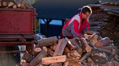 Preparing for winter with pile of firewood Stock Footage