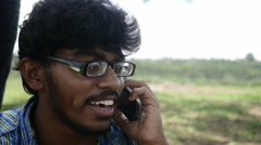 Young indian man talking on the phone - stock footage